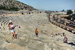 Ancient amphitheater, Tourists take photos themselves on backgro Stock Images