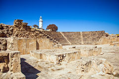 The ancient amphitheatre in Paphos, Cyprus. The ancient amphitheatre in Paphos with lighthouse on the background Royalty Free Stock Images