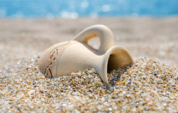 Ancient amphora on the beach Royalty Free Stock Image