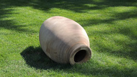 Ancient clay jug. The ancient earthen vessel on the lawn in the Park in the Crimea. The Park of the ancient Greek culture Stock Image