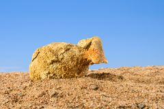 Ancient amphora lying on the sand against the blue sky, Greece stock photography