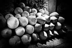 Ancient amphoras in pile. Grained black and white monochrome image Stock Image