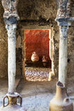 Ancient amphoras. Ancient Roman amphoras inside a roman building Stock Image