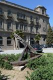 Ancient anchor in the street of Barcelona. Royalty Free Stock Photo