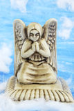Ancient angel. Angel sitting on the white clouds in the sky Royalty Free Stock Photography