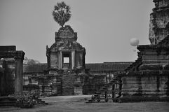 Ancient Ankgor Wat. Old Cambodian temple with background of blue sky and jungle in black and white Royalty Free Stock Photos