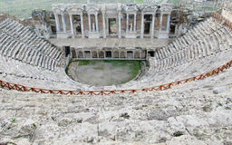 Ancient antique amphitheater ruins of Hierapolis Stock Photography