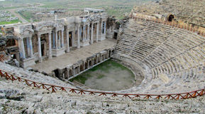 Ancient antique amphitheater ruins of Hierapolis Stock Images