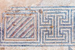 Ancient, antique mosaic of small colored tiles with geometric pattern. stock photography