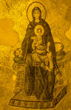 Ancient Apse mosaic of the Theotokos (Virgin Mother and Child) i Stock Photos