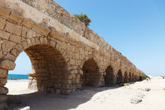 Ancient aqueduct at Caesarea. Stock Photos