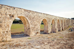 Ancient aqueduct in Larnaca, Cyprus. Sunset horizontal image Stock Images