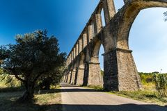 Acueducto de los Pegoes in Portugal. Ancient aqueduct located in the city of Tomar, which supplied water to the Convent of Christ stock image