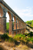Ancient  aqueduct in sunny day Stock Image