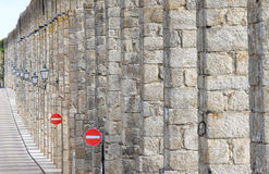The ancient aqueduct and traffic signs, Portugal Royalty Free Stock Image