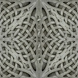 Ancient Arabesque Stone Ornament. Stone arabesque photo manipulated digital art pattern background in gray tones Royalty Free Stock Image
