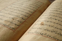 Ancient arabic book. Ancient open book in arabic. old arabic manuscripts Royalty Free Stock Image