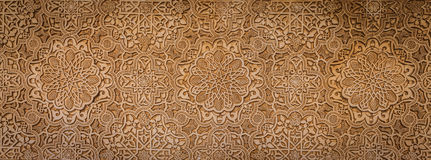Ancient Arabic Characters. Wall detail of Alhambra UNESCO site in Granada - South of Spain. 600 years old arabic characters Royalty Free Stock Photos