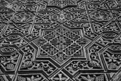 Ancient Arabic Characters. Wall detail of Alhambra UNESCO site in Granada - South of Spain. 600 years old arabic characters Stock Photos
