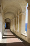 Ancient arcades passageway. Archway in the old town of Imperia, Italy Stock Image