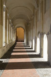 Ancient arcades passageway. Archway in the old town of Imperia, Italy Stock Photos