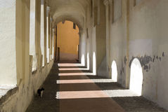 Ancient arcades passageway. Archway in the old town of Imperia, Italy Royalty Free Stock Image