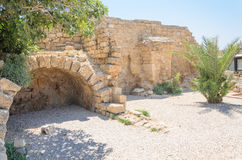 Ancient arch of bricks and wall in ancient park in Caesarea,  Israel Royalty Free Stock Photography