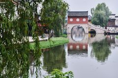 Ancient arch bridge in spring in Zhejiang, China. 。The water has a beautiful reflection Stock Image