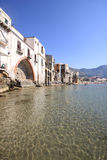 Ancient arch at Cefalu sea front Royalty Free Stock Photography