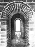 Ancient arch in China, old brick wall and floor texture in b/w. Use as background, backdrop, image montage in vintage or retro style; or visual content relate Stock Photo
