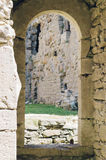 Ancient arch doorway in construction of medieval castle. Selective focus Royalty Free Stock Images