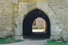 Ancient arch doorway of medieval castle. Ancient arch doorway leading through passage of medieval castle Stock Image