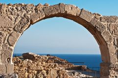 Ancient arch at Kourion, Cyprus. Beautiful view at sea Stock Image