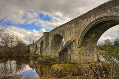 Ancient arched stone bridge Stock Photo