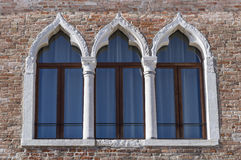 Ancient arched windows typical of Venice. Trio of ancient arched windows typical of Venice Royalty Free Stock Photos