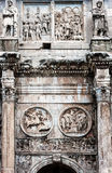 Ancient architectonic detail. Detail of the column and relief in the arch of Constantine in Rome, Italy Stock Photography