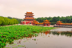Ancient architectural buildings in lotus pond Stock Photo