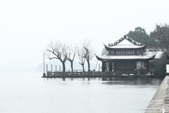 Ancient Architectural Buildings,West Lake(xihu) in Hangzhou of China in winter after the snow Royalty Free Stock Image