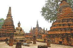 Ancient architecture of Buddhist temples in Sukhothai Historical Royalty Free Stock Photo