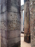 Ancient architecture of Cambodia, Angkor Wat temple. Historic building, columns with beautiful frescoes, the ancient architecture of Cambodia, Angkor Wat temple Stock Photo