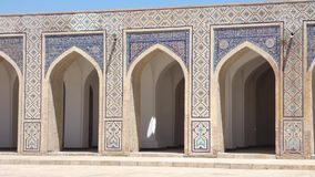 Ancient architecture of Central Asia and East. The old building, the wall with arches. Ancient buildings of medieval Asia. Bukhara, Uzbekistan stock video footage
