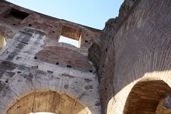 Ancient architecture Colosseum in Roma Italy. Day Stock Photos