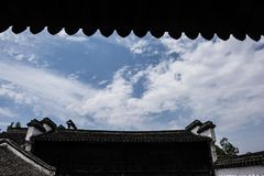 Ancient architecture cylindrical eaves silhouette under blue sky and white clouds. Wuxi, Huishan, Jiangsu ancient town, blue sky and white clouds, silhouette of Stock Photography