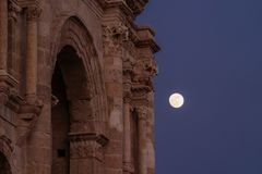 Ancient architecture detailed at night with full moon in Jerash in Amman, Jordan stock image