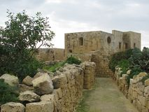 Ancient architecture is preserved in Malta. Traditional classic style. Stone walls of houses, fortresses, fortifications are preserved in Malta Stock Images