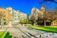 Ancient architecture in Sibenik, Croatia. Scenic view at famous old square in Sibenik historical town, Dalmatia region royalty free stock images