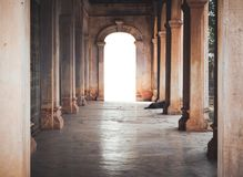 An ancient archway with light. Beam of the success back of the door ,an ancient archway royalty free stock images