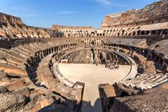 Ancient arena of gladiator Colosseum in city of Rome, Italy. ROME, ITALY - JUNE 24, 2017:  Ancient arena of gladiator Colosseum in city of Rome, Italy Royalty Free Stock Photos
