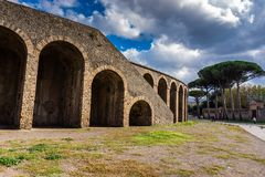 Ancient arena in the ruins of Pompeii. Ancient arena in the ruins of Roman Imperial city Pompeii near volcano Vesuvius, Italy, landmark, amphitheater, stage royalty free stock image
