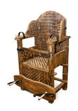 The ancient armchair for tortures Stock Photos
